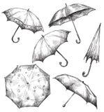 Uppsättning av paraplyteckningar som hand-dras stock illustrationer