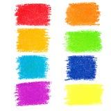Uppsättning av pastellfärgade färgpennafläckar för regnbåge Arkivbild