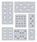Uppsättning av preventivpillerar, minnestavlor och kapslar i blåsor stock illustrationer