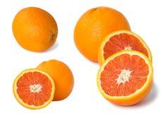Uppsättning av röd orange frukt som isoleras på vit Arkivfoton