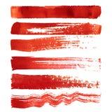 Uppsättning av röda borsteslaglängder Fotografering för Bildbyråer