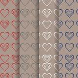 Uppsättning av röda grå färger för valentin, vit, blå hjärta på brun bakgrund Arkivfoton