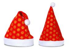 Uppsättning av röda isolerade Santa Claus hattar Arkivfoto