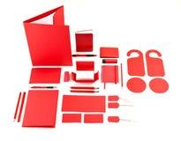 Uppsättning av röda mallar för företags identitet på vit Royaltyfri Fotografi