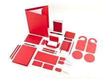 Uppsättning av röda mallar för företags identitet på vit Arkivfoto