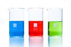Uppsättning av resistenta cylindriska dryckeskärlar för temperatur med färgflytande Royaltyfria Bilder