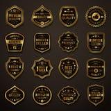 Uppsättning av Retro guld och svarta högvärdiga kvalitetsemblem Arkivbilder