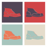 Uppsättning av retro mäns skor royaltyfri illustrationer