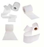 Uppsättning av rullar för toalettpapper som isoleras på vit royaltyfria foton