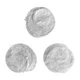 Uppsättning av runda silverfläckar Arkivfoto