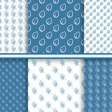Uppsättning av sömlösa blom- modeller i blåa färger Royaltyfri Bild