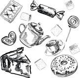 Uppsättning av sötsaker, muffin och te Arkivfoto