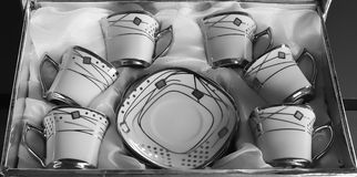 Uppsättning av sex porslinkoppar kaffe Arkivfoto