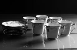 Uppsättning av sex porslinkoppar kaffe Arkivbild