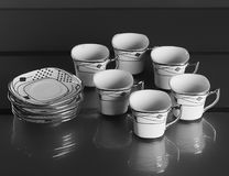 Uppsättning av sex porslinkoppar kaffe Fotografering för Bildbyråer