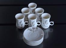 Uppsättning av sex porslinkoppar kaffe Arkivfoton