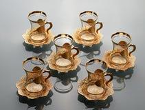 Uppsättning av sex tomma tulpan-formade kopp te Royaltyfri Bild