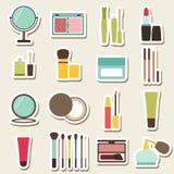 Uppsättning av skönhet och färgrika symboler för skönhetsmedel Arkivfoto