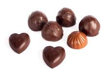 Uppsättning av smakliga choklader som isoleras på vit bakgrund Royaltyfri Fotografi