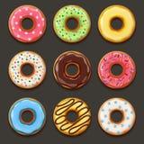 Uppsättning av smakliga donuts Arkivbild