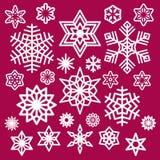 Uppsättning av snöflingasymboler för vit jul på vin Arkivfoton