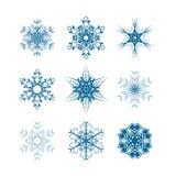 Uppsättning av snöflingasymboler som isoleras på vit stock illustrationer