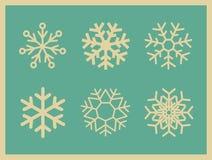 Uppsättning av snöflingor för tappningvektorsymboler Royaltyfri Bild