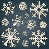 Uppsättning av snöflingor från gammalt papper Arkivfoton