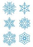 Uppsättning av snöflingor på vit bakgrundsvinterferie royaltyfria foton