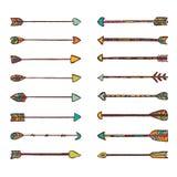 Uppsättning av stam- traditionella pilar stock illustrationer