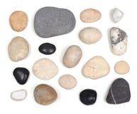 Uppsättning av stenar på vit Royaltyfri Foto