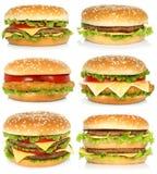 Uppsättning av stora hamburgare på vit bakgrund Royaltyfri Foto