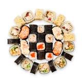 Uppsättning av sushi, maki, gunkan och rullar som isoleras på vit Royaltyfri Foto