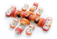 Uppsättning av sushi, maki och rullar som isoleras på vit bakgrund Royaltyfri Bild