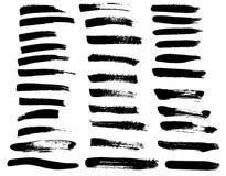 Uppsättning av svarta fläckar för målarfärgborste Royaltyfri Bild