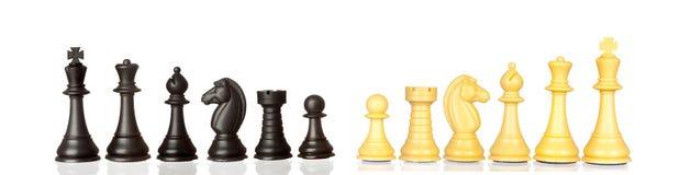 Uppsättning av svartvita schackstycken Royaltyfri Bild