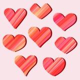 Uppsättning av texturerade hjärtor på rosa bakgrund Royaltyfri Bild