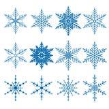 Uppsättning av tolv blåa vektorsnöflingor Royaltyfri Bild