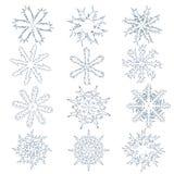 Uppsättning av tolv snöflingor Design för nytt år och jul Arkivfoton