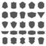 Uppsättning av tomma tomma mörkersköldar Sköldemblemformer Tappningramar för emblem, etiketter, gradbeteckning stock illustrationer