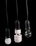 Uppsättning av tre elektriska lampor i uttag på svart Royaltyfri Foto