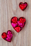Uppsättning av tre hjärtagodisar arkivbilder