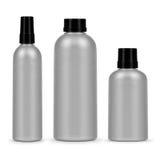 Uppsättning av tre kosmetiska flaskor på en vit bakgrund Royaltyfri Foto