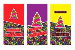 Uppsättning av tre ljusa färgrika klassiska julhälsningskort Arkivbilder