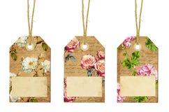 Uppsättning av tre tappningetiketter med blommor Royaltyfri Foto