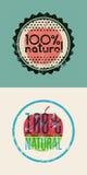 Uppsättning av två etiketter naturlig 100% Rubber stämpel för Grunge för 100 procent naturprodukt för designeps för 10 bakgrund v Arkivfoton