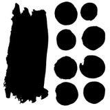 Uppsättning av vattenfärgfläckar i svart färgpulver Arkivbild