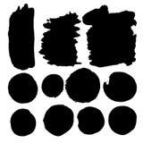 Uppsättning av vattenfärgfläckar i svart färgpulver Arkivbilder