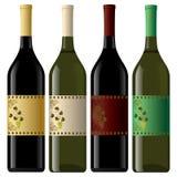 Uppsättning av vit- och rött vinflaskor. Arkivbild