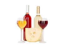 Uppsättning av vit och rosa vinflaskor, glas. Royaltyfri Foto